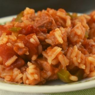 Our Jambalaya with Ham is the perfect leftover ham recipe after the holidays.  This quick jambalaya is a one pan version that comes together in 30 minutes.