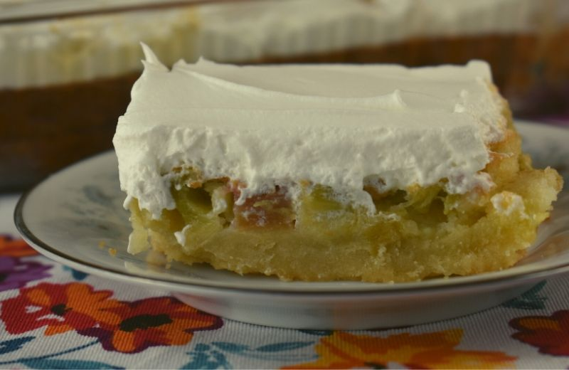 What's better than a dream? Layers of buttery shortbread, rich rhubarb custard and cool whipped topping make this Rhubarb Dream Cake a favorite of among all rhubarb recipes.