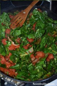 Braised Collard Greens with Tomatoes is a simple new spin on collard greens. This Italian-inspired recipe might be the first step to getting your family to eat their greens.
