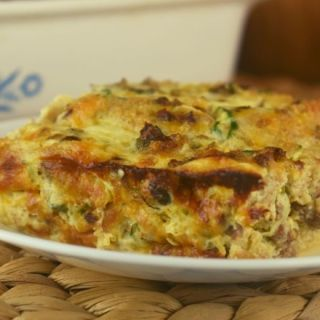 Breakfast is served with this egg casserole full of sausage, cheese, bread cubes and a secret ingredient---zucchini.  That's right, trick your kids into eating their veggies in the morning with this breakfast casserole with zucchini.