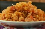 Authentic Spanish Rice may be traditional but it's also simple with just a handful of ingredients including long-grain white rice, water, chicken broth, tomato sauce and Rotel canned tomatoes. With a lot of stirring and a little patience, you too will master this easy side dish.