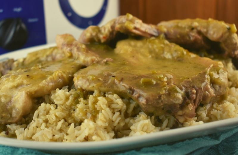 Mexican Style Crock Pot Pork Chops are a slowed cooked pork chop recipe in an easy 3 ingredient green chili sauce. Try serving over rice to absorb all the extra southwest flavor.