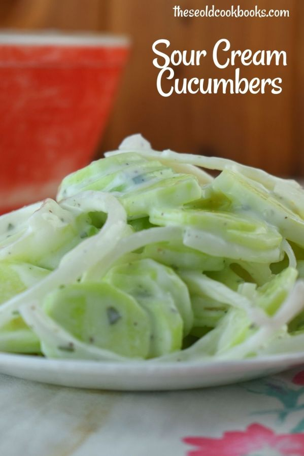 Simple Sour Cream Cucumbers is an old fashioned summer salad featuring garden cucumbers and onions. The sauce is a delightfully easy sour cream base flavored with with a pinch of tarragon.
