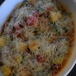 Healthy Zucchini Tomato Casserole includes a menagerie of fresh garden veggies sauteed together. Before serving, a layer of shredded Parmesan cheese is melted over top for the perfect finishing touch.