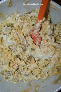 Chicken Ole Casserole (with cream of chicken soup) is a wide egg noodles and chicken casserole with the perfect amount of spice.  This easy chicken casserole recipes for dinner is a winner with the whole family.