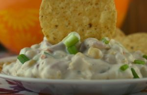 Mexicorn Crack Dip is a corn dip with Rotel and ranch seasonings. With only six simple ingredients, it's an easy corn dip to prepare and easier to eat. Serve at your next party or holiday with a bag of tortilla chips.