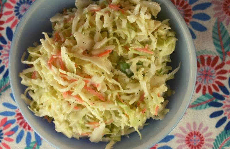 This homemade coleslaw dressing recipe is easy as can be with only four ingredients plus salt and pepper. Simple and Sweet Coleslaw goes together in a pinch for the perfect side dish.