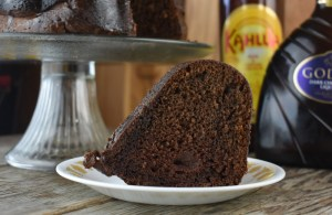 Chocolate Kahlua Bundt Cake is a light and airy double chocolate cake doused in a sweet, boozy glaze. It starts with a two shortcut ingredients, cake mix and pudding mix and is jazzed up with two types of booze, Kahlua and Crème de Cacao. Traditionally, this boozy chocolate cake is called a Black Russian Cake.