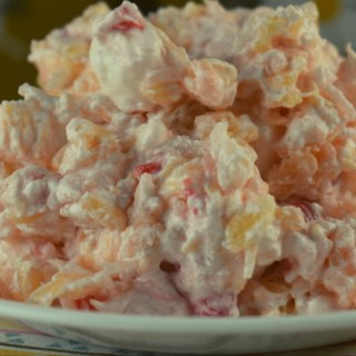 Glorified Rice is an old fashioned dessert salad consisting of white rice, mini marshmallows, pineapple, maraschino cherries and Cool Whip. Served cold, this vintage recipe is perfect for summer.