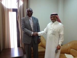 Saudi Fund -  Momodu Kargbo in warm hand shake with the Saudi Fund Director General