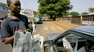 Newspaper seller in Freetown