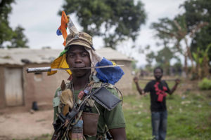 Anti-balaka fighters from the town of Bossembele patrol in the Boeing district of Bangui