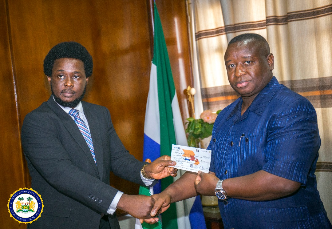 Francis Ben Kaifala hands over recovered stolen funds to president Bio 1