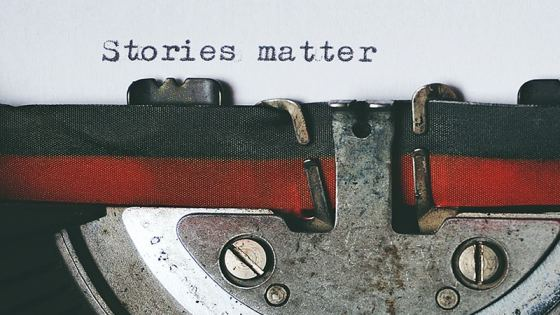 A sheet of paper in a typewriter that reads Stories Matter