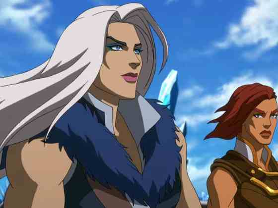 Evil-Lyn has long white hair blowing in the wind with Teela behind her