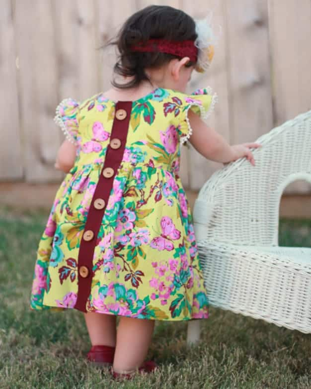 Baby Helena's Button Back Top and Dress. PDF Sewing Patterns Baby Sizes NB-24 Months. Top, Dress, Spring, Summer, Fall, Winter, Pintuck Placket, Button Back, Sleeveless, Sleeves, Baby, Newborn, Flutters, High-Low
