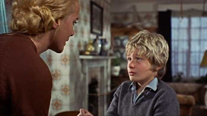 Sylvia Sims and Mark Lester