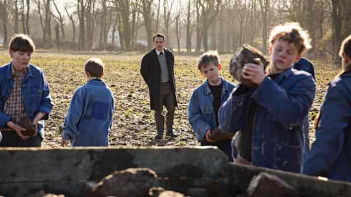 """The boys are forced to work in the fields as part of their """"education"""""""