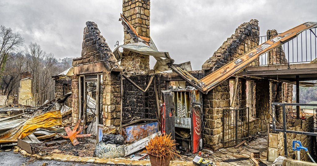 Only the shell of a motel office remains after being destroyed by a forest fire in Gatlinburg (Carolyn Franks / Shutterstock.com)