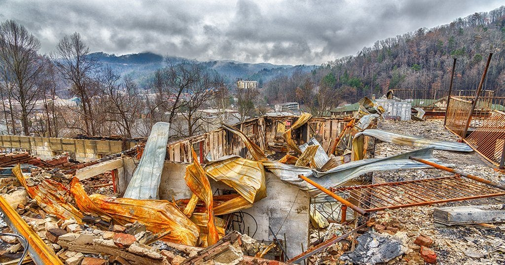 A motel complex lies in ruins after a major forest fire roared through Gatlinburg and a large section of the Smoky Mountains in late December 2016 (Carolyn Franks / Shutterstock.com)