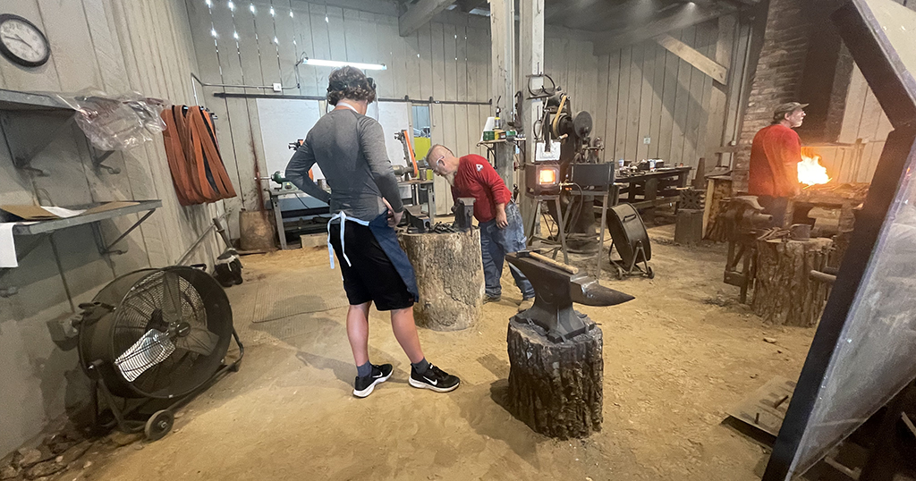 A guest makes a knife at Dollywood