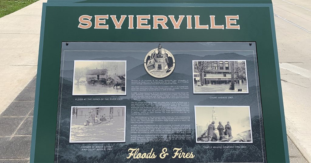 Signage about floods and fires in downtown Sevierville