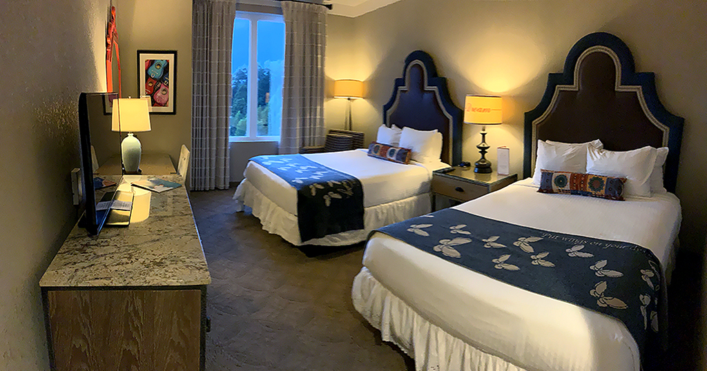 A standard room featuring two beds at DreamMore