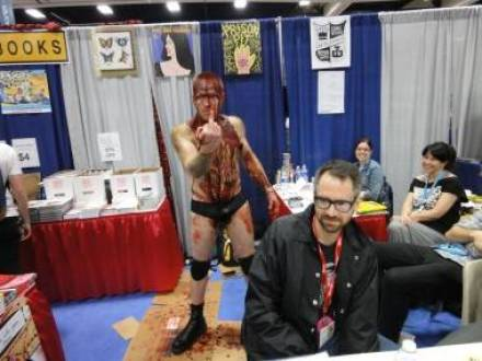 Cartoonist Johnny Ryan and his character F*ckface from the Fantagraphics series Prison Planet.