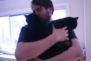 Jarrett with both cats