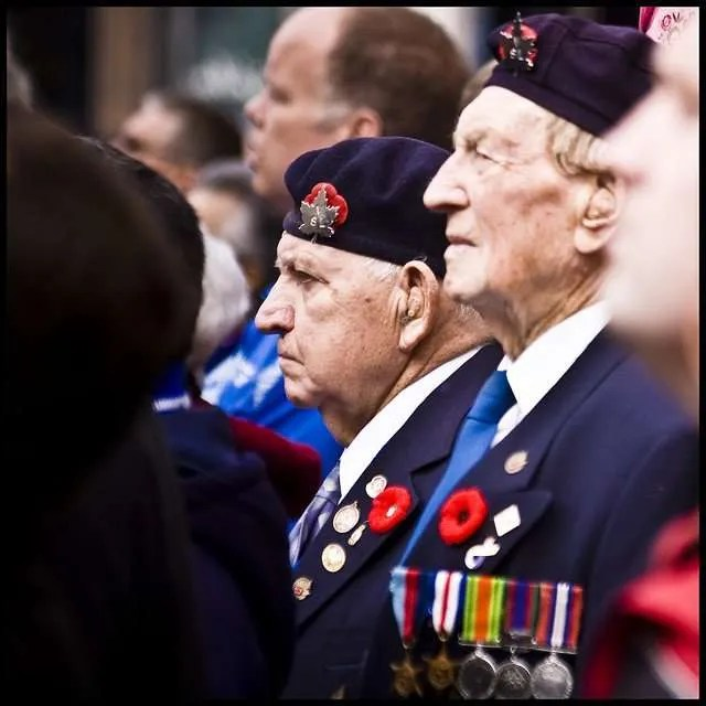 Two veterans in the crowds along King Street in Hamilton