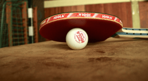 ping pong bat and a ball