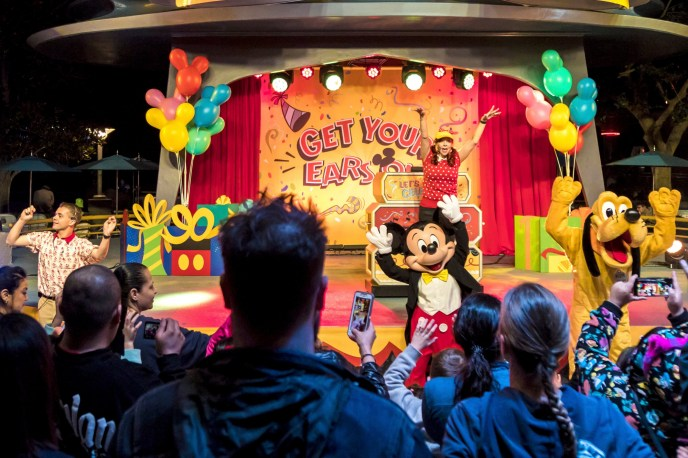 Mickey and Pluto dancing at Get Your Ears on Party