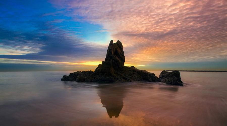 A rock in the ocean in Newport Beach, California.