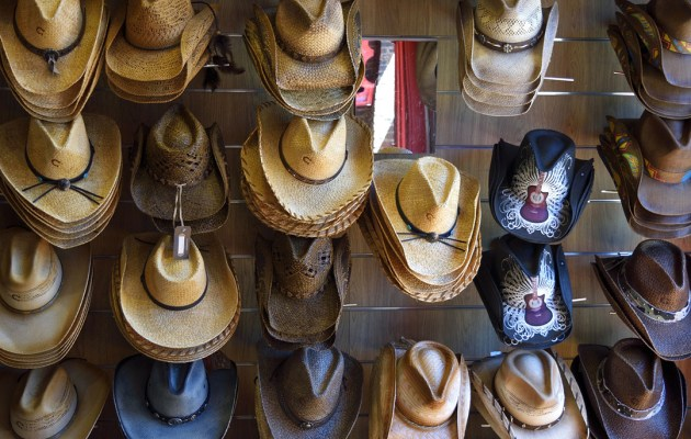 Cowboy hats on a wall in Nashville.