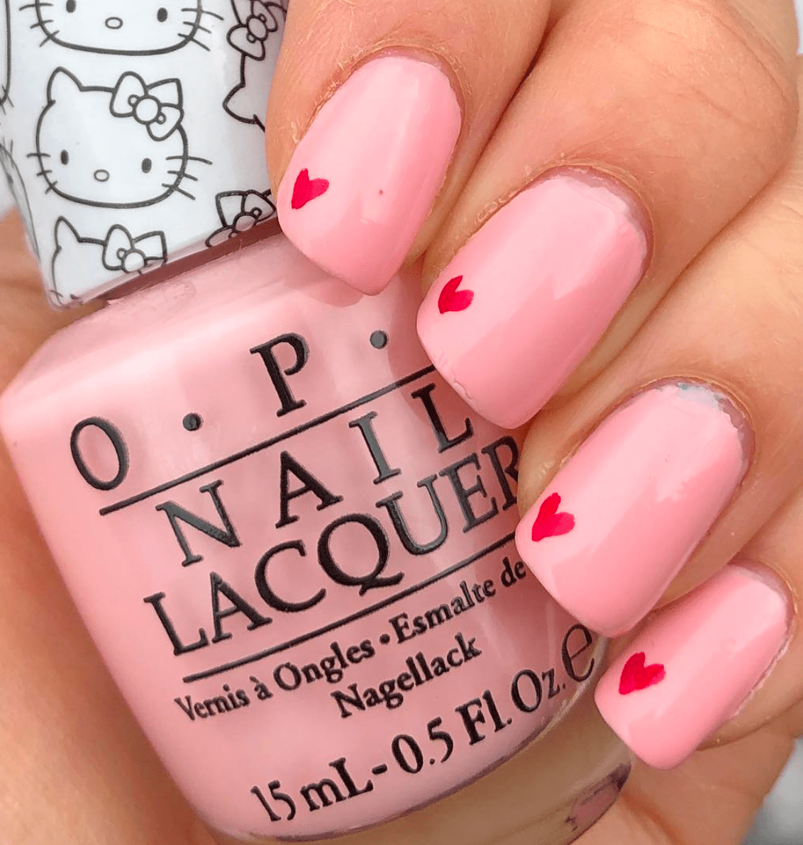Super sweet pink nails with mini red hearts