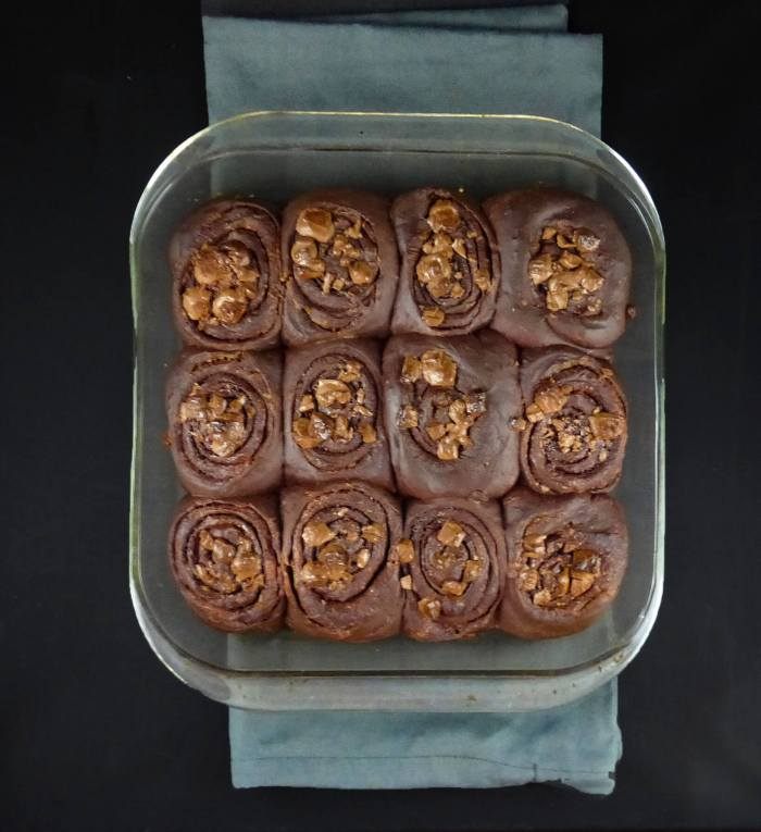 picture of chocolate cinnamon buns on a grey cloth