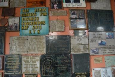 Plaques thanking the 'evil saint'
