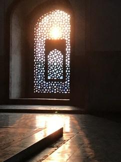 The sun setting into the mausoleum