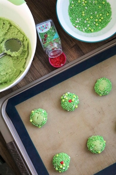 Rolling out dough to make Grinch Heart Thumbprint Cookies #anolon #sweetssquad