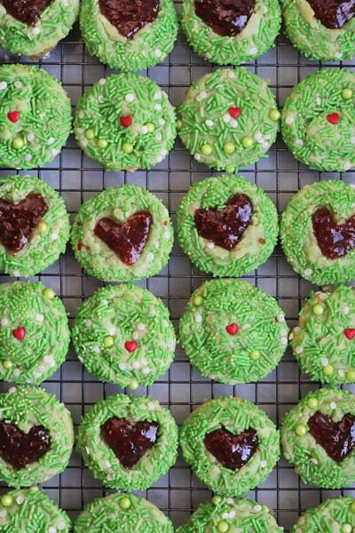 Grinch Heart Thumbprint Cookies cooling on a wire rack