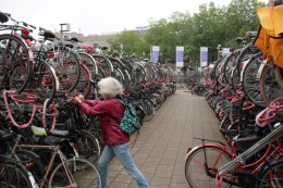 Ellen places her bike on the first top level of this 3,000 bicycle parking near Central Station Utrecht