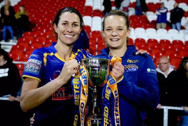 Courtney Winfield-Hill and Lois Forsell (right) celebrate Leeds' Grand Final win in 2019
