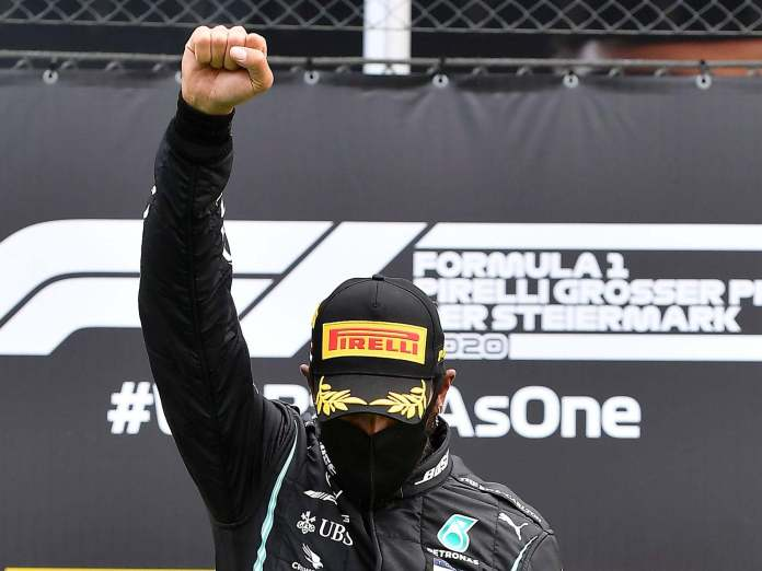 Lewis Hamilton with the power salute.