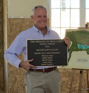 Developer Allen Harris presents plaque to City of Opelika officials.