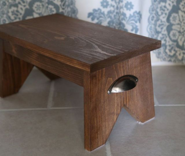 A Wooden Single Step Stool On A Tile Floor