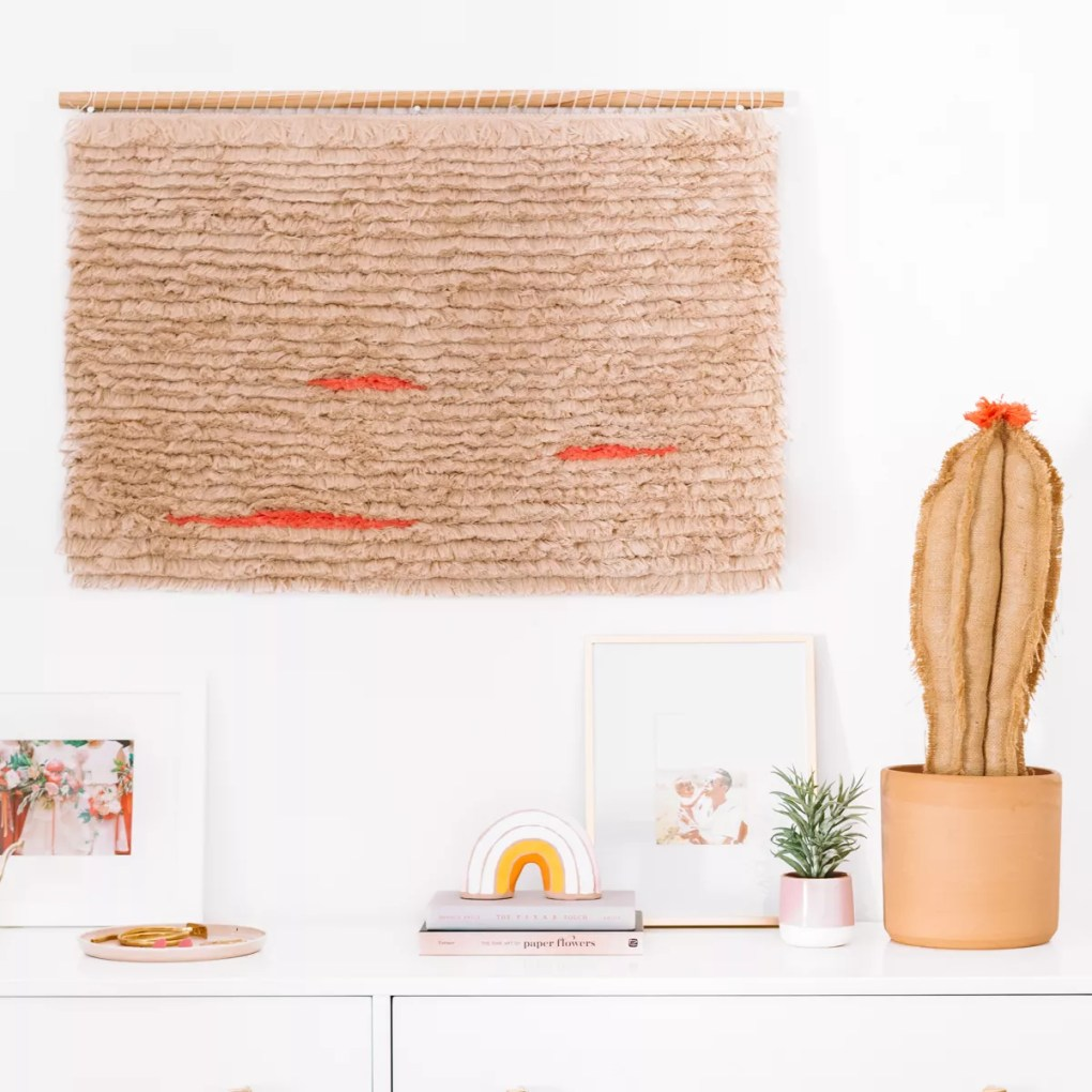 A DIY fringe wall hanging in red and tan