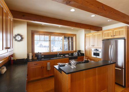 kitchen counter tops glass tables 20 options for countertops spacious high quality open plan with exposed beams ceiling wood cabinets