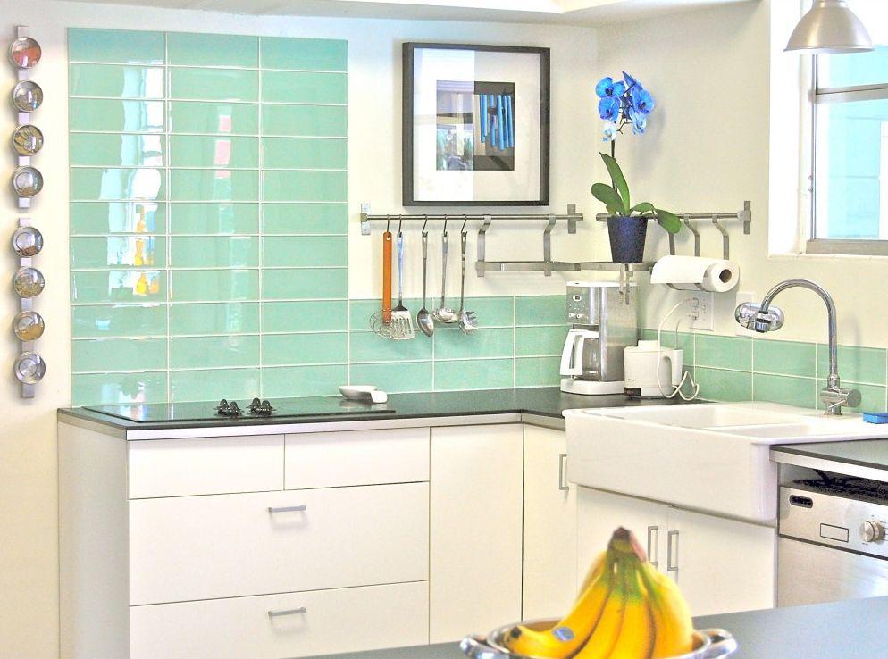 green subway tile kitchen backsplash