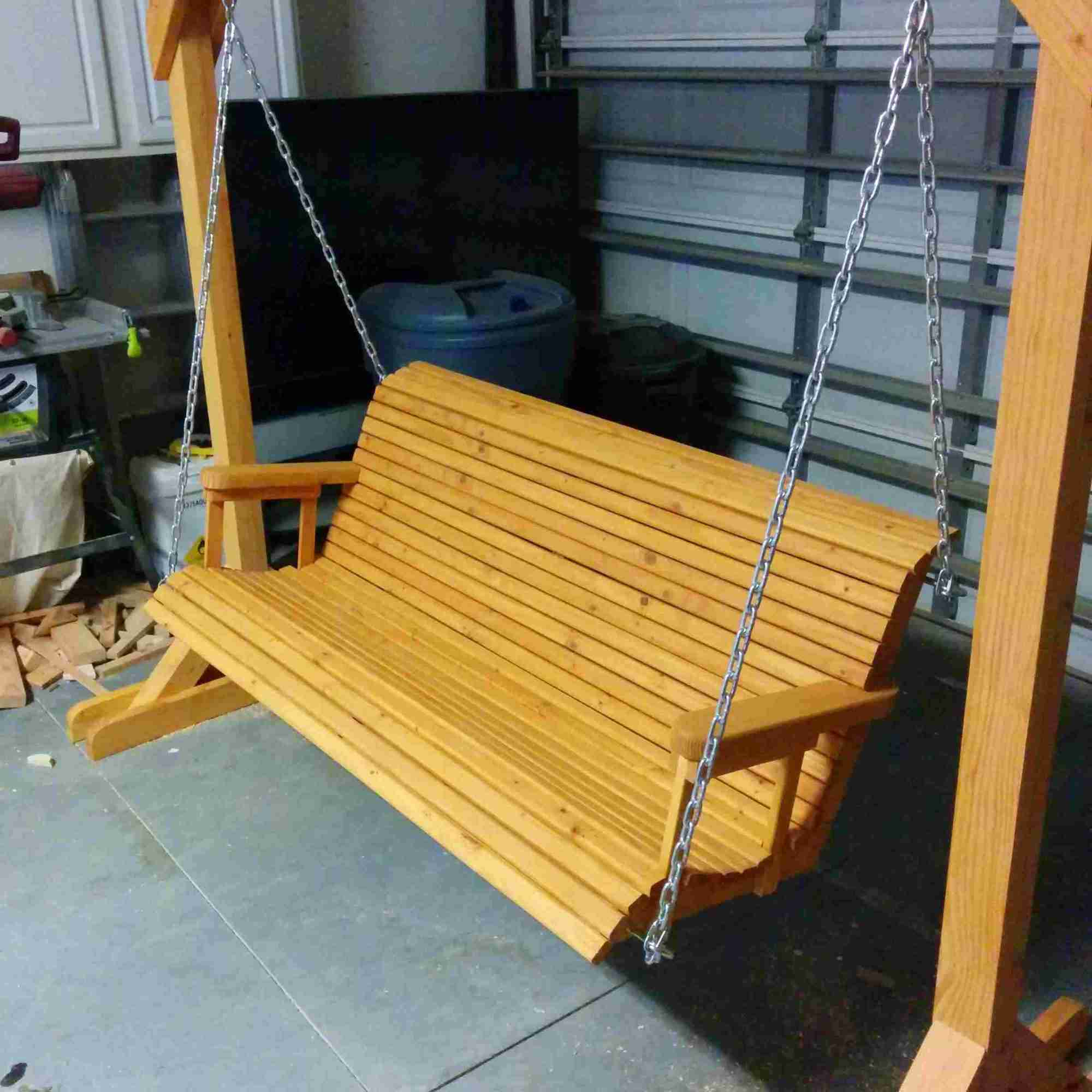 hight resolution of a porch swing in a garage