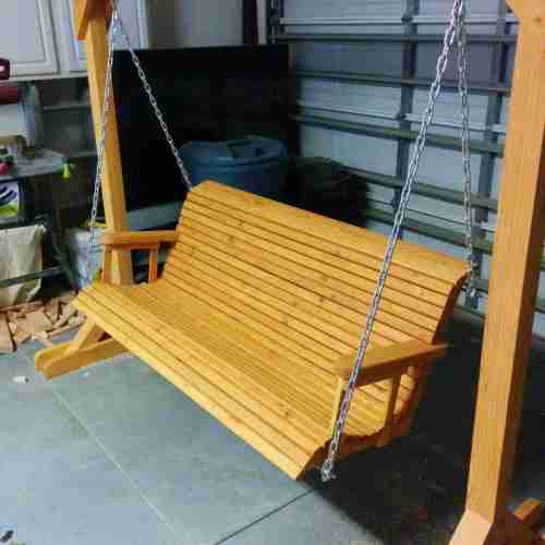 small resolution of a porch swing in a garage